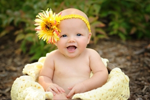 1 year old with yellow flower photo