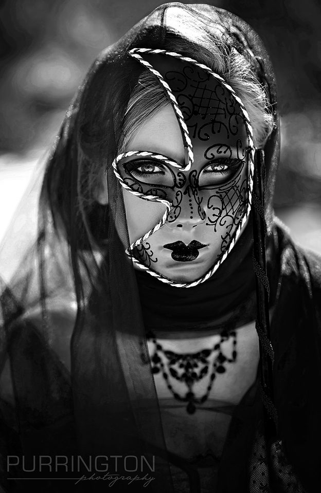 girl woman in a mask dramatic black and white